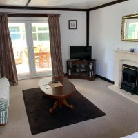 Coed Cottages Marchod Apartment Lounge and Conservatory
