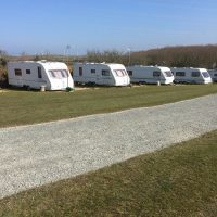 Coed Cottages Hard standing with electric hook-up for tourers